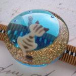 月夜猫の帯留 茶トラブルー